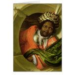 Retrato Moor que celebra una bandera en una ventan Tarjetón