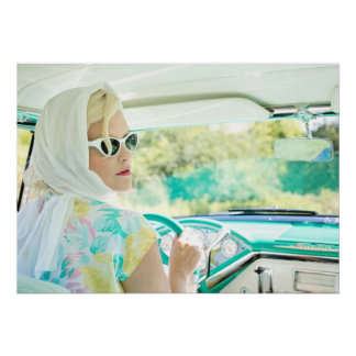 Retro 1950s model driving a vintage turquoise car… poster