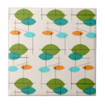 """Retro Atomic Mobile Pattern Ceramic Tile<br><div class=""""desc"""">This Retro Atomic Mobile Pattern Ceramic Tile is mid century modern style at its finest. The vintage inspired design features a cream background with colorful pointed ovals in turquoise, orange, teal, and avocado green. The teal and avocado green ovals overlap creating a lovely shade of peacock blue. Fun starbursts accentuate...</div>"""