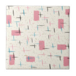 """Retro Atomic Pink Pattern Ceramic Tile<br><div class=""""desc"""">You&#39;ll be tickled pink by this Retro Atomic Pink Pattern Ceramic Tile. The design features a cream background with gold speckles, pink rectangles, and black, turquoise, and pink slashes. The pattern is reminiscent of traditional mid century modern style. You&#39;re sure to enjoy our homage to the 1950s. Buy this today...</div>"""