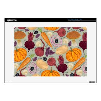 "Retro background from fresh vegetables 15"" laptop skins"
