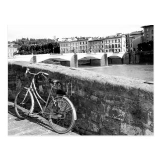 Retro Bicycle next to a bridge in Florence Postcard
