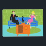 """Retro Couple with Cat Laminated Placemat<br><div class=""""desc"""">This Retro Couple with Cat Laminated Placemat features a cartoon couple trying to get cozy while watching television on a mid century modern, blue sofa. The cat, however, has other ideas. On one side of the sofa, there is a handsome man in a black suit with red tie. On the...</div>"""