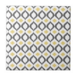 "Retro Geometric Ikat Yellow Gray Pattern Tile<br><div class=""desc"">Retro inspired geometric shape ikat ogee pattern in grey,  white and yellow.  A cool designer stylish modern pattern that combines geometry and a traditional tribal textile texture.</div>"