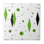 """Retro Green Diamonds &amp; Starbursts Ceramic Tile<br><div class=""""desc"""">This customizable Retro Green Diamonds and Starbursts Ceramic Tile is a new take on a vintage style. It features kitschy, black starbursts on green polka dots, surrounding geometric, green and black diamond shapes. Customize the background color on this mid century modern product if you&#39;re feeling daring, or leave it white...</div>"""
