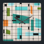 """Retro Grid &amp; Starbursts Acrylic Wall Clock<br><div class=""""desc"""">This Retro Grid and Starbursts Acrylic Wall Clock is where vintage style meets modern day. It features a cream colored background with kitschy, off kilter squares and rectangles in teal, turquoise, This light blue, orange, and avocado green. The whimsical blocks of color are overlayed are worked into some of the...</div>"""
