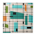 "Retro Grid &amp; Starbursts Tile<br><div class=""desc"">This Retro Grid and Starbursts Tile is where vintage style meets modern day. It features a cream colored background with kitschy, off kilter squares and rectangles in teal, turquoise, This light blue, orange, and avocado green. The whimsical blocks of color are overlayed are worked into some of the grid intersections....</div>"