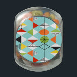 """Retro Harlequin Pattern Glass Candy Jar<br><div class=""""desc"""">This Retro Harlequin Pattern Glass Candy Jar is mid century modern style at its finest. The vintage inspired design features an aqua background with rows of triangular shapes forming a harlequin pattern. The two-toned diamond shapes are yellow, white, red, orange, black, green, and white with black accents. But wait, there's...</div>"""