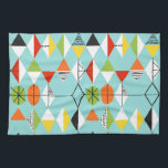 "Retro Harlequin Pattern Kitchen Towel<br><div class=""desc"">This Retro Harlequin Pattern Kitchen Towel is mid century modern style at its finest. The vintage inspired design features an aqua background with rows of triangular shapes forming a harlequin pattern. The two-toned diamond shapes are yellow, white, red, orange, black, green, and white with black accents. But wait, there's more!...</div>"