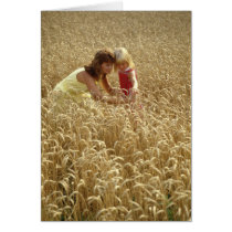 Retro-look Mother and Daughter in Wheat Field