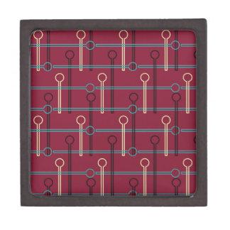 Retro Pattern Gold Black Swizzle Sticks on Red Jewelry Box