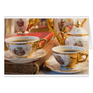 Retro porcelain coffee cups with hot espresso card