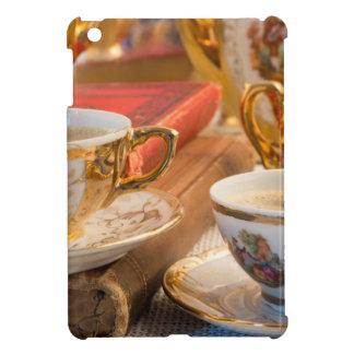 Retro porcelain coffee cups with hot espresso iPad mini case