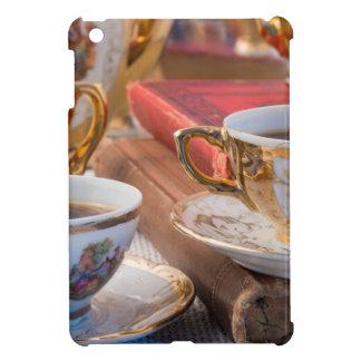 Retro porcelain coffee cups with hot espresso iPad mini covers