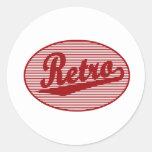 Retro script logo in red round stickers