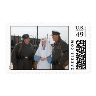 Retro styled picture with nurse and two soldiers postage stamps