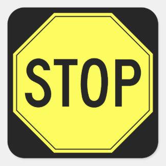 Retro yellow stop sign on black square sticker