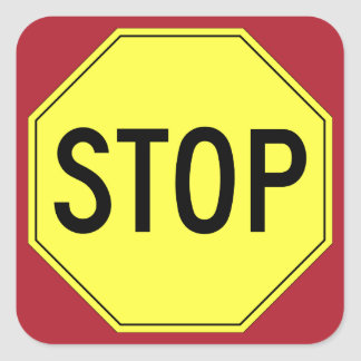 Retro yellow stop sign on red square sticker