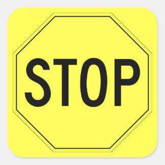 Retro yellow stop sign on yellow square sticker