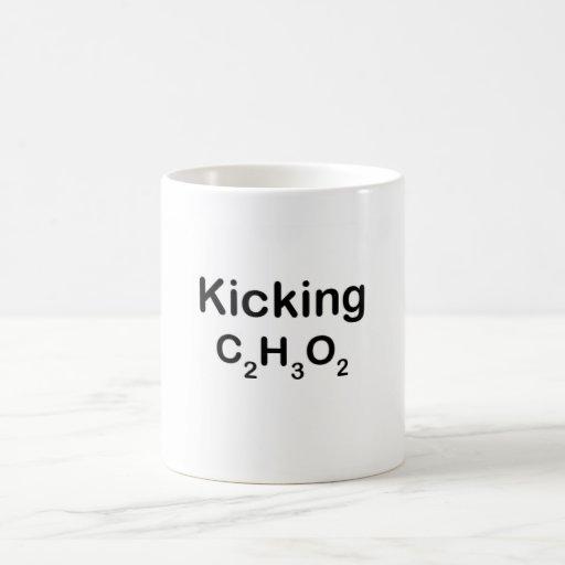 Retroceso del acetato con el pie taza