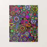 """Retromania 2 Jigsaw Puzzle<br><div class=""""desc"""">A jigsaw puzzle with a lively and colorful design of peace signs,  paisley,  ankhs,  hearts,  and flowers. A far-out flash back to the 1960&#39;s.</div>"""