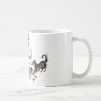 Reunión de la taza del navidad del perro