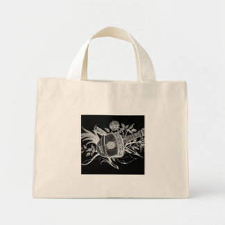 Reverse black and white of a lute and flowers tote bags