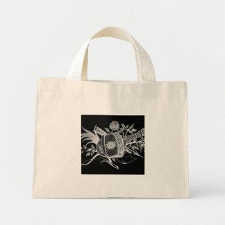 Revés blanco y negro de un laúd y de flores bolsa tela pequeña