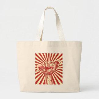Revolution fist holding money concept jumbo tote bag