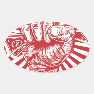 Revolution fist holding money concept oval sticker