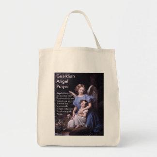 Rezo del ángel de guarda con el chica bolsa tela para la compra