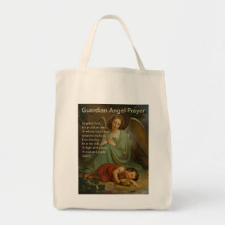Rezo del ángel de guarda con el muchacho bolsa tela para la compra