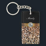 "Rhinestone Monogram Keychains<br><div class=""desc"">Monogram keychains with pretty diamond jewel rhinestones digitally printed and gold monogram emblem you can make your own by personalizing it with any name, initials, or message. Leopard style animal print background gives your keychain a stylish look. Designed as keychains for women or keychains for girls, in a fun acrylic...</div>"