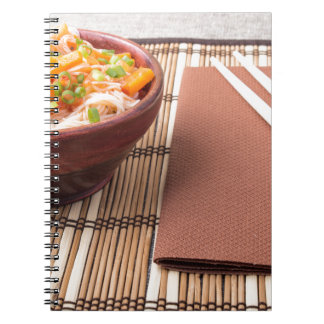Rice vermicelli hu-teu in a small brown bowl notebook