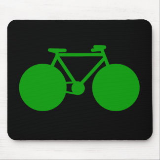 ride on . green bicycle on black mouse pad