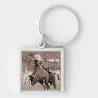 Rider about to fall off bucking bull keychain