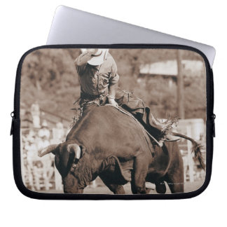 Rider about to fall off bucking bull laptop sleeve