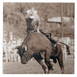 Rider about to fall off bucking bull large square tile
