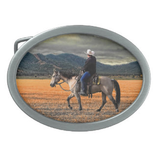 RIDER BENEATH A SISKIYOU SKY OVAL BELT BUCKLE