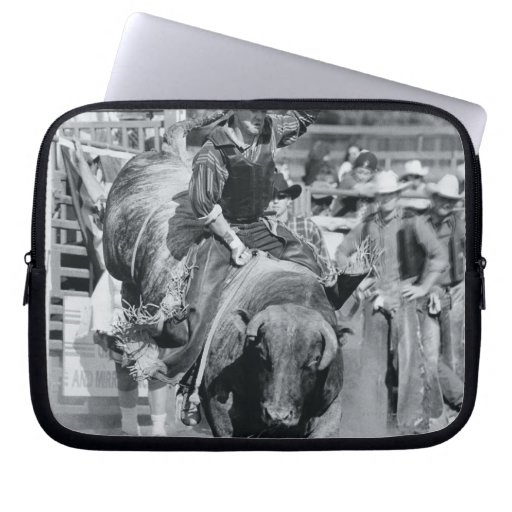 Rider hanging on to bucking bull computer sleeves