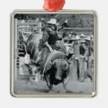 Rider hanging on to bucking bull christmas tree ornaments