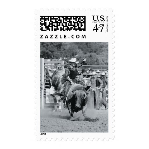 Rider hanging on to bucking bull stamp