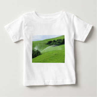 Ridge on alpine pasture with grass sprinklers baby T-Shirt