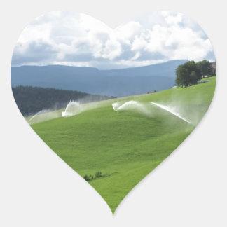Ridge on alpine pasture with grass sprinklers heart sticker