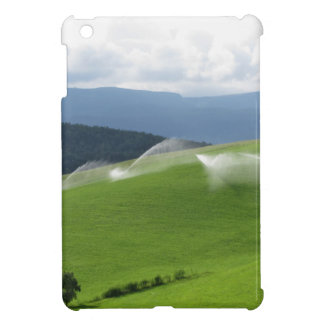 Ridge on alpine pasture with grass sprinklers iPad mini case