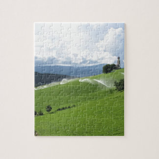 Ridge on alpine pasture with grass sprinklers jigsaw puzzle