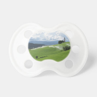 Ridge on alpine pasture with grass sprinklers pacifier