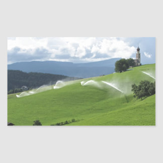 Ridge on alpine pasture with grass sprinklers rectangular sticker