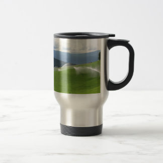 Ridge on alpine pasture with grass sprinklers travel mug