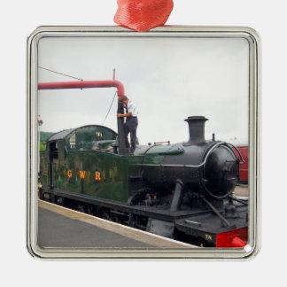 Riego de una locomotora de vapor adorno cuadrado plateado